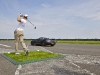 Coulthard and Shepherd Set Record World's Farthest Golf Shot Caught in Moving Car
