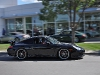 Porsche 911 speeding away from Distinctive Collection
