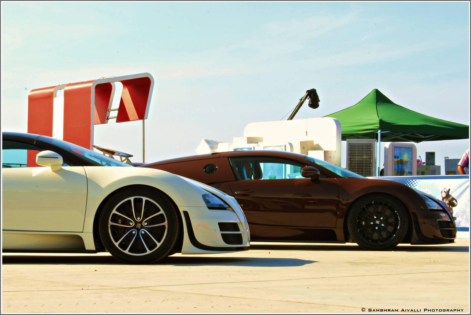 three bugatti veyrons wow at dubai parachuting championship. Black Bedroom Furniture Sets. Home Design Ideas