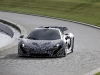 Jenson Button Arrives at MP4-28 Unveiling in McLaren P1 Prototype