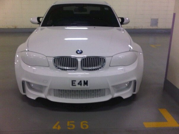 Overkill White BMW 1-Series M Coupe in Singapore