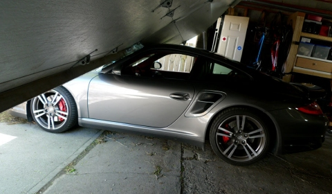 Car Crash: Son Launches Porsche Turbo Press Car Through Garage Door