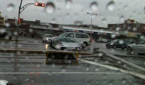 Car Crash Lambo Fights Traffic Light Pole in Quebec Canada 01