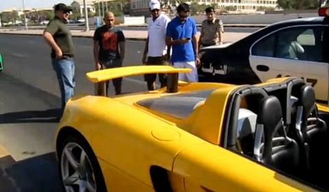Car Crash Yellow Porsche Carrera GT in the Middle East