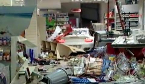 Car Crash Woman Drives Porsche 911 Turbo into Gas Station Store