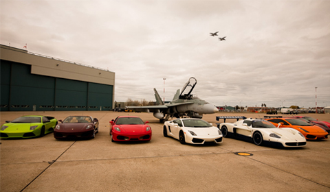 Race the Base 2010 cars posing with the CF-18 Fighter Jet