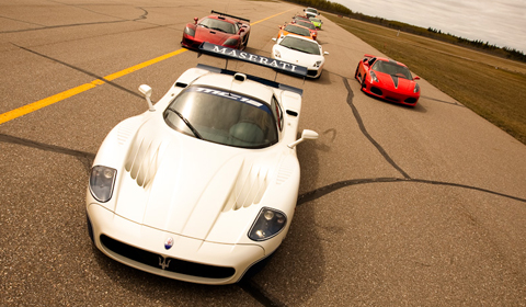 Maserati MC12 being chased down the runway by its competition