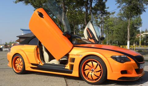 Overkill: Bright Orange BMW M6 with scissor doors