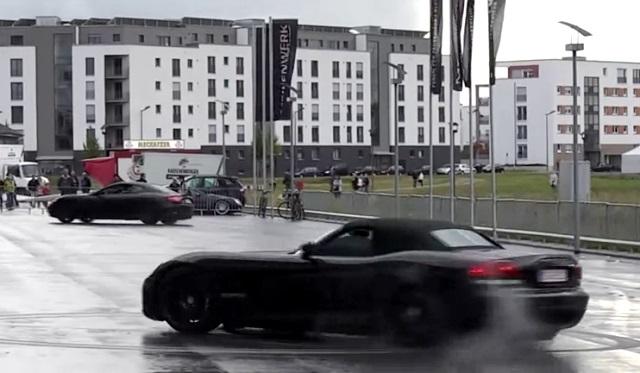 A Maserati Gran Turismo and a Dodge Viper Doing Donuts Simultaneously