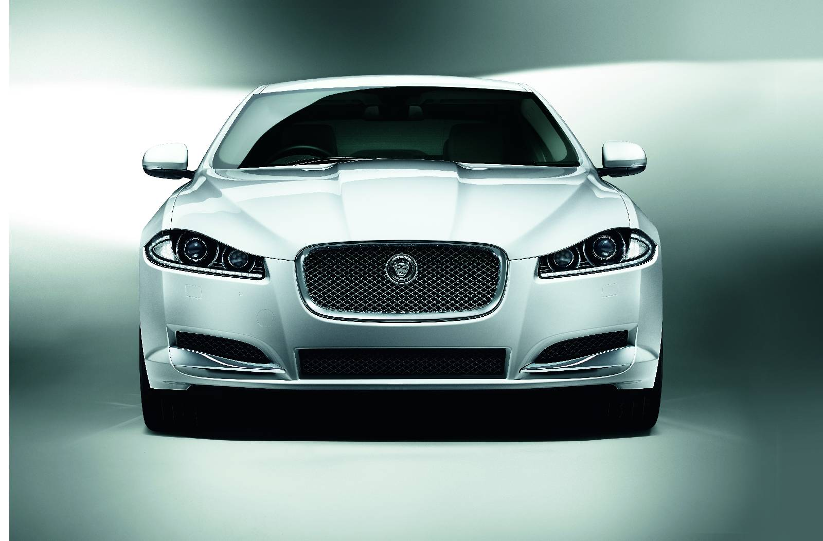 Jaguar Has Revealed The 2014 XF That Comes With The New And Efficient  Four Cylinder, 2.2 Litre Diesel 163PS ECO2 Engine. The Car Will Be  Available In Both ...