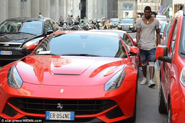 Mario Balotelli Snapped With new Ferrari F12 Berlinetta