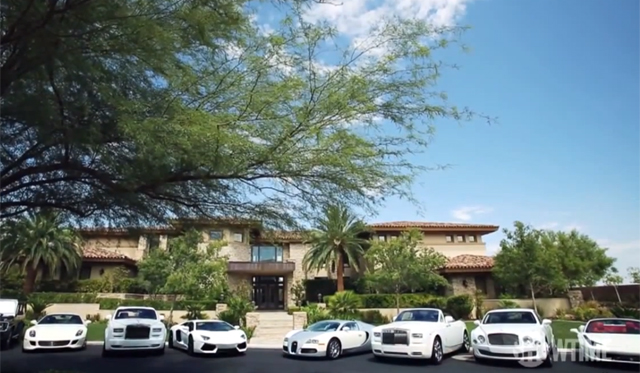 Mayweather and his toys includes a Bugatti Veyron!!!