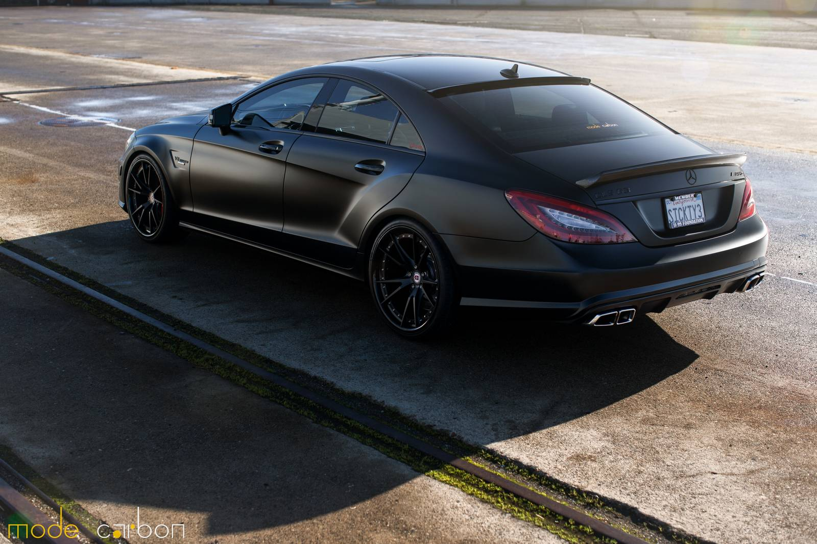 Matte black mercedes benz cls63 amg s by mode carbon for Matte mercedes benz