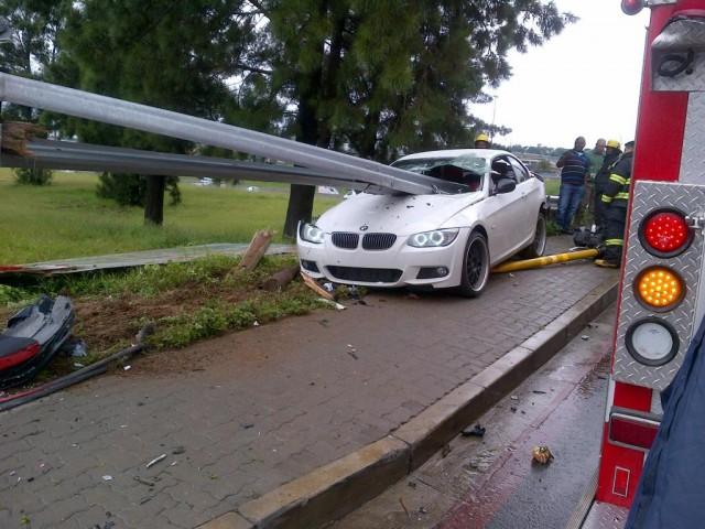 Guard Rail Pierces Through BMW 335i in Horrific Crash