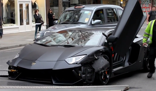 Wrecked Matte Black Lamborghini Aventador Towed