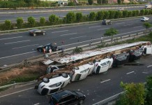 Trailer Carrying Luxury Cars Rolls Over in China Damaging All