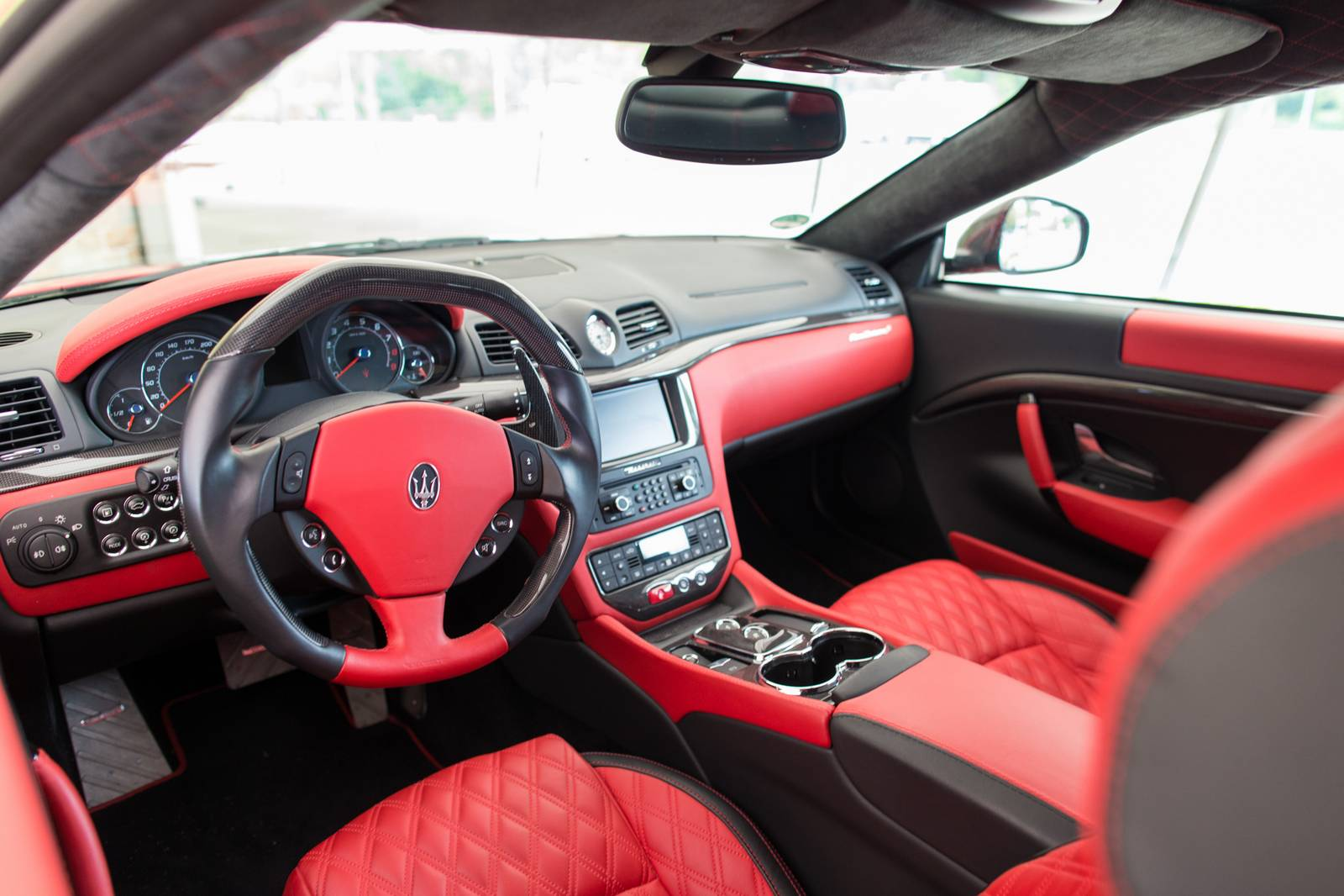 Mansory maserati granturismo s rosso mondiale review for White maserati red interior