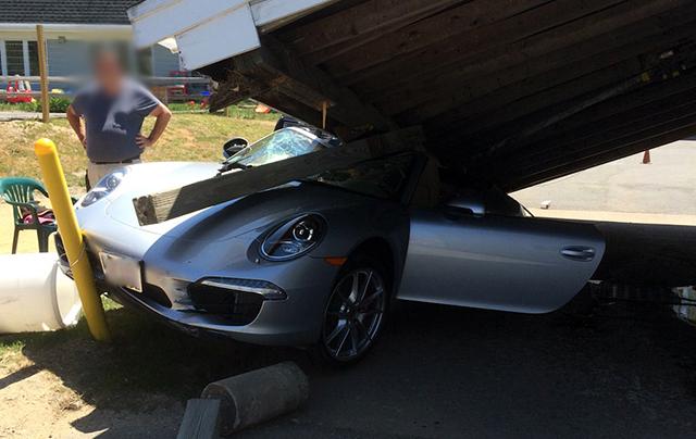 Porsche 911 crashes into car wash front