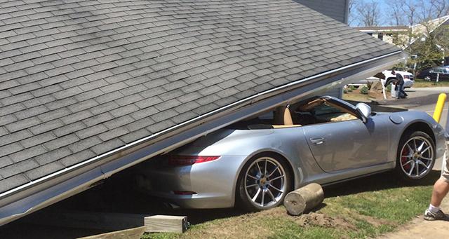 Porsche 911 crashes into car wash rear