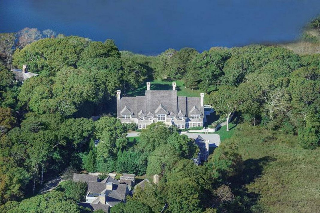 Aerial view mansion with pond front