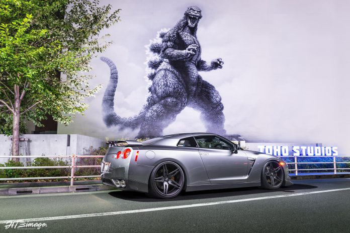 Grey Nissan GT-R and Godzilla