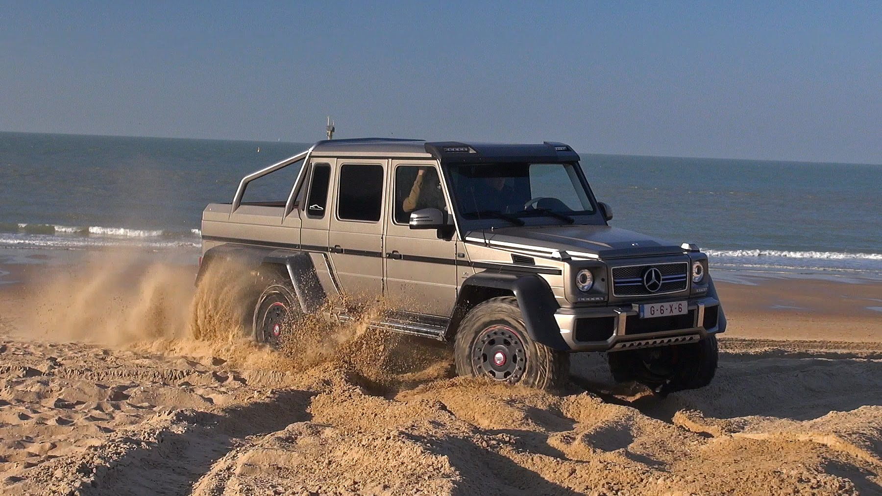 Video mercedes benz g63 amg 6x6 tares up the beach for Mercedes benz g63 6x6 for sale