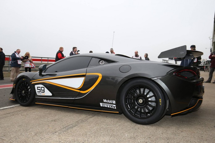 McLaren 570S GT4 showing off its rear wing mounted on aluminum pylons