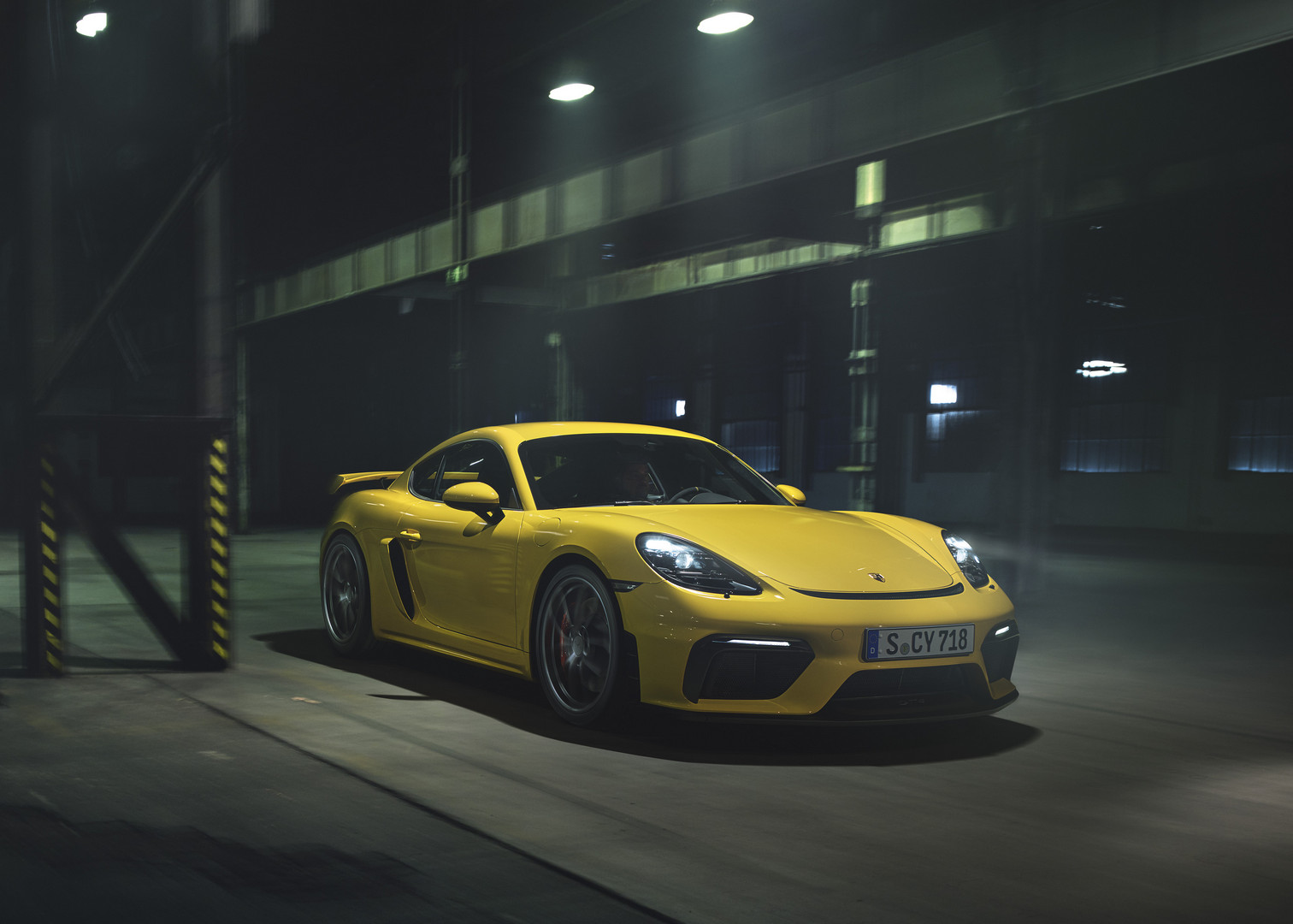 Yellow Porsche 718 Cayman GT4